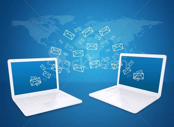 Two laptops exchange letters Stock photo © cherezoff