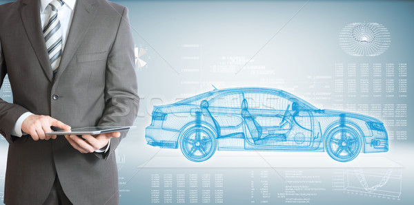 Businessman with tablet pc and high-tech car Stock photo © cherezoff