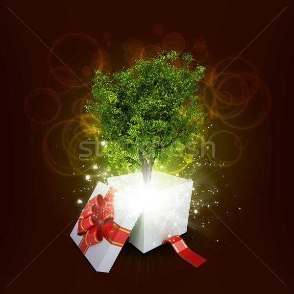 Gift box with magical green tree Stock photo © cherezoff