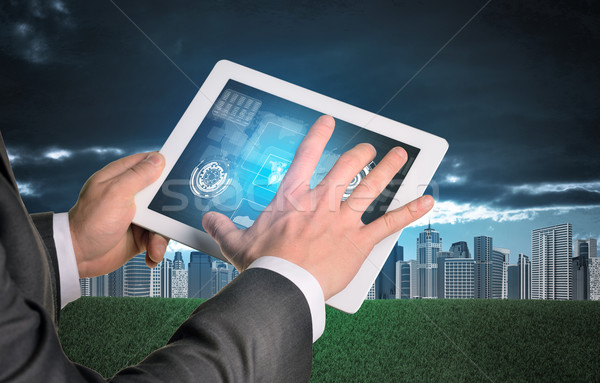 Man hands using tablet. Virtual elements on touchscreen Stock photo © cherezoff