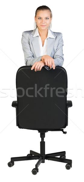 Businesswoman Kneeling On Office Chair Looking At Camera Cheerfully Stock Photo C Kirill Cherezov Cherezoff 5202187 Stockfresh