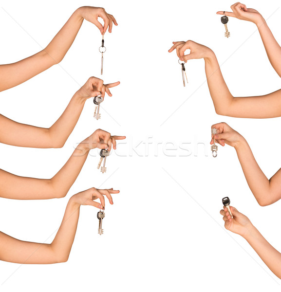 Womans hands holding house keys on white isolated background Stock photo © cherezoff