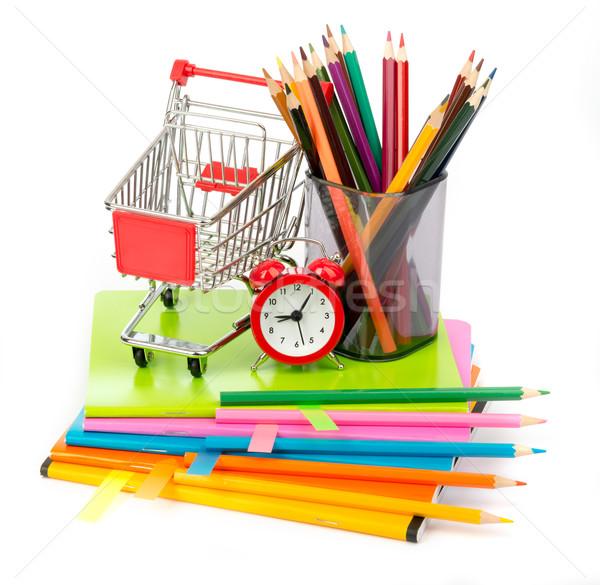 Shopping cart with crayons and alarm clock Stock photo © cherezoff