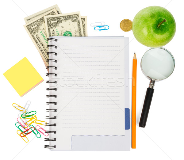 Open notebook with stationery and apple Stock photo © cherezoff