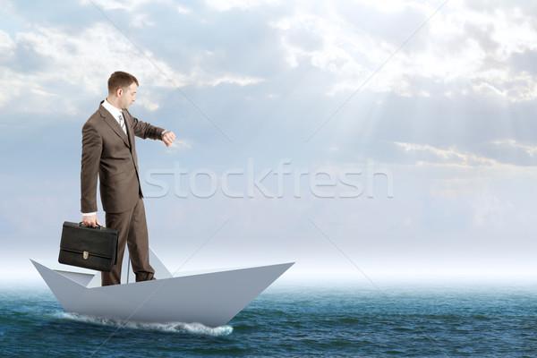 Businessman in paper boat Stock photo © cherezoff