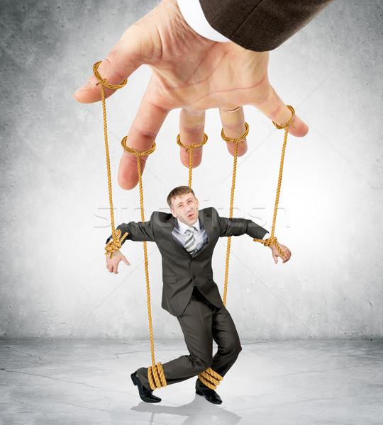 üzletember akasztás ahogy marionett kép fotózás Stock fotó © cherezoff
