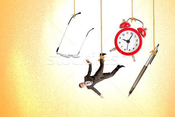Man hanging on rope with clock, pen and glasses Stock photo © cherezoff
