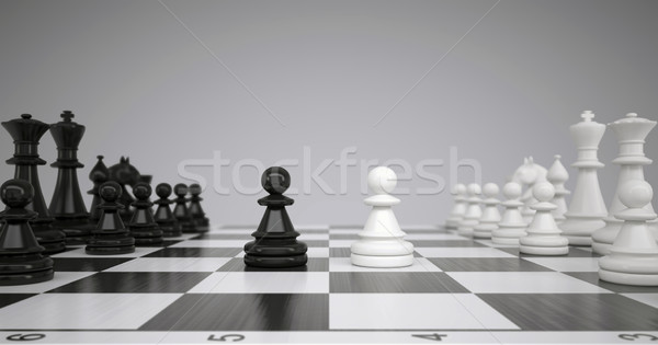Two pawns in the middle of a chessboard Stock photo © cherezoff