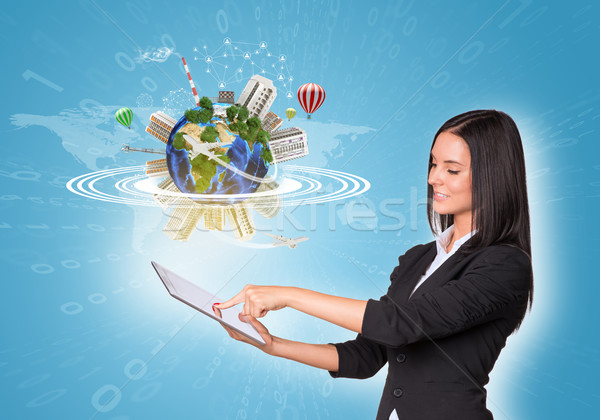 Women using digital tablet and Earth with buildings Stock photo © cherezoff