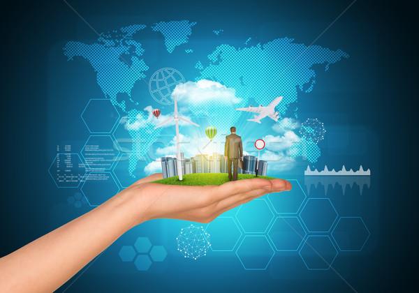 ストックフォト: 手 · 市 · 高層ビル · 緑の草 · ビジネスマン · 徒歩