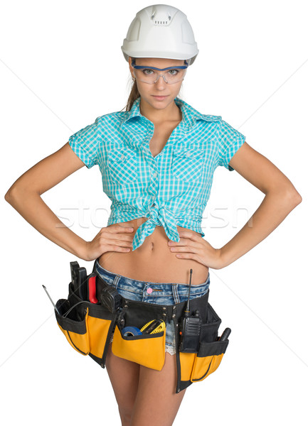 Woman in hard hat, tool belt and protective glasses Stock photo © cherezoff