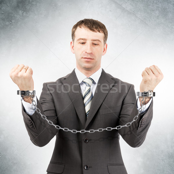Businessman in cuffs  Stock photo © cherezoff