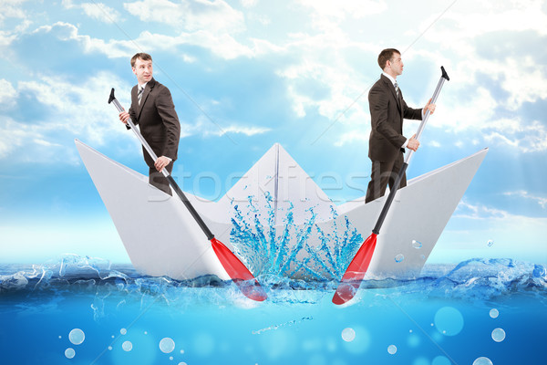 Two businessmen in paper boat Stock photo © cherezoff
