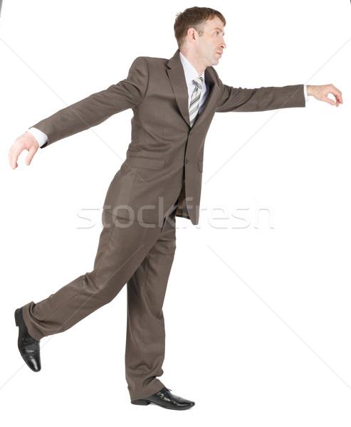 Businessman balancing on one leg Stock photo © cherezoff