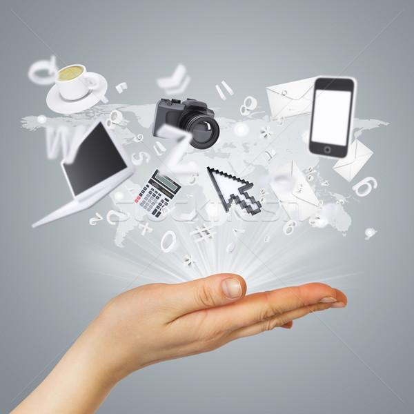 Hand and electronics Stock photo © cherezoff