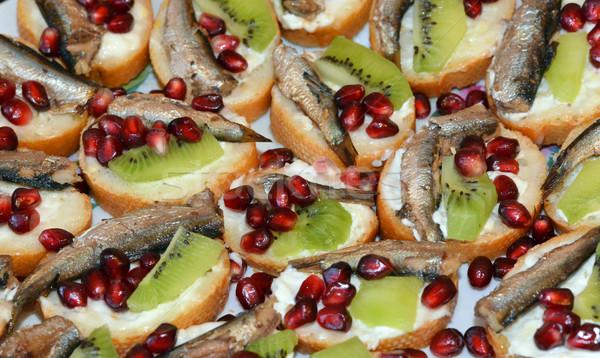 Sandwiches sprat, kiwi and pomegranate seeds Stock photo © cherezoff