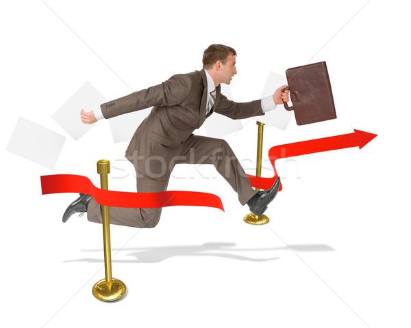 Businessman with suitcase finishing Stock photo © cherezoff