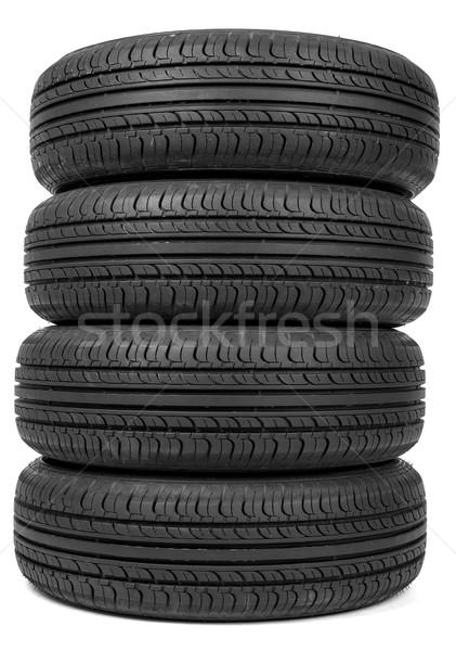 Stack of four new black tyres Stock photo © cherezoff