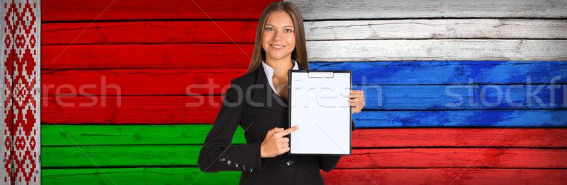üzletasszony tart papír Fehéroroszország orosz zászlók Stock fotó © cherezoff