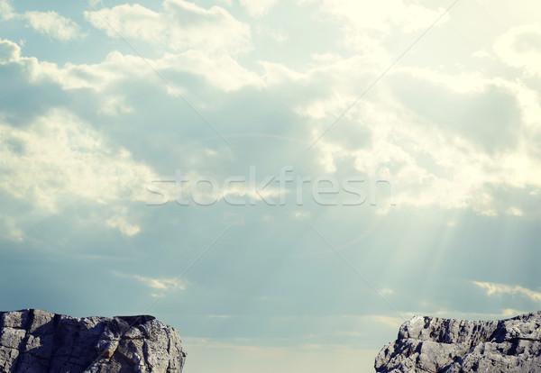 Brecha camino dos rocas cielo nubes Foto stock © cherezoff