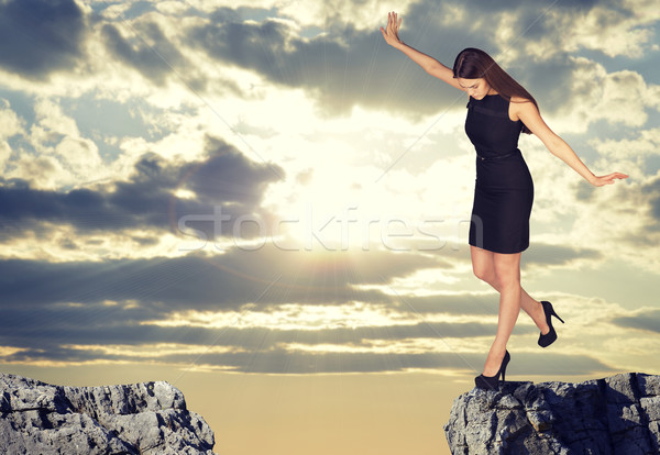 Businesswoman standing on the edge of rock gap Stock photo © cherezoff