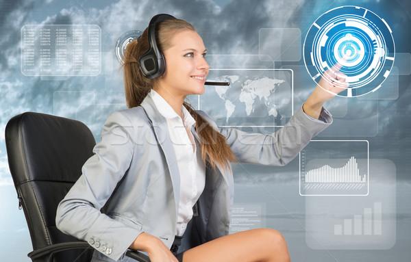 Businesswoman in headset using virtual interface Stock photo © cherezoff