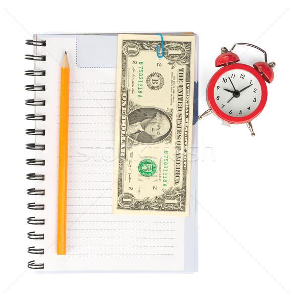 Copybook with alarm clock and cash Stock photo © cherezoff