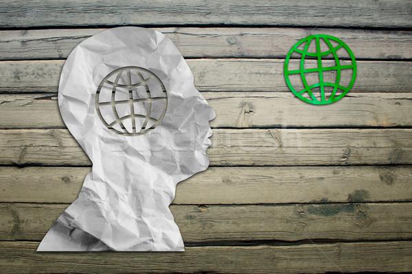 Paper humans head with globe symbol Stock photo © cherezoff