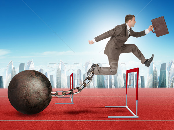 Businessman jumping over barrier Stock photo © cherezoff