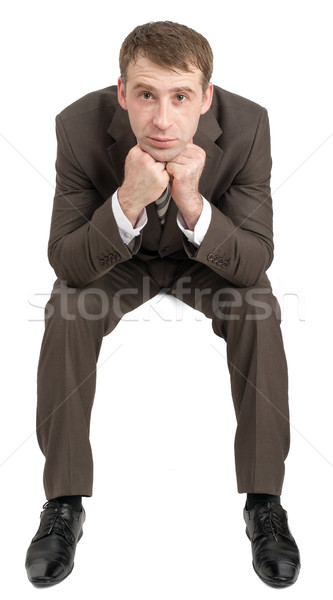 Businessman sitting on empty space Stock photo © cherezoff
