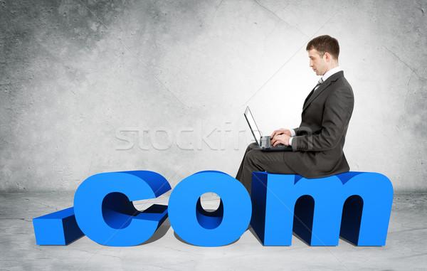 Businessman working on laptop Stock photo © cherezoff