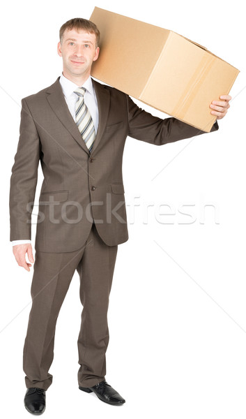 Young courier with carton box on shoulder Stock photo © cherezoff