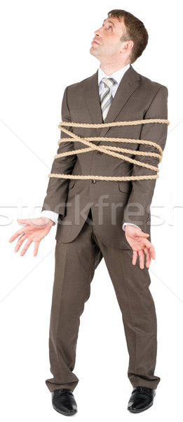 Businessman tied with rope Stock photo © cherezoff