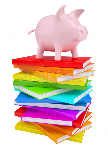 Pink piggy bank on a stack of colorful books Stock photo © cherezoff