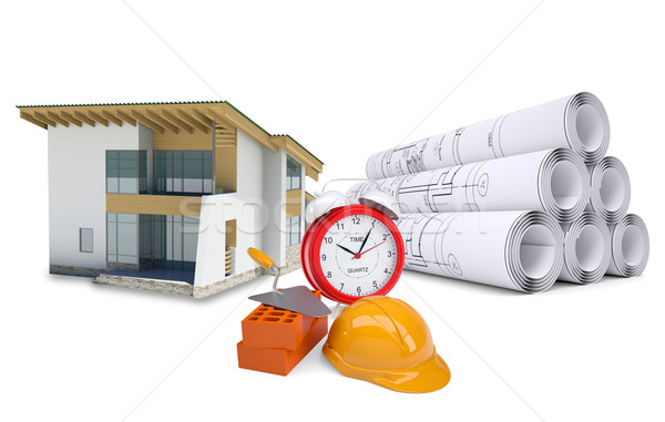 Small model house near scrolls of architectural drawings and alarm clock Stock photo © cherezoff
