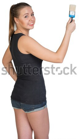 Woman holding paint-brush Stock photo © cherezoff