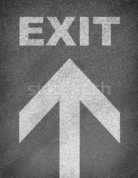 Stock photo: Asphalt road texture with arrow and word exit