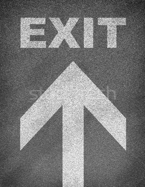 асфальт дороги текстуры стрелка слово выход Сток-фото © cherezoff