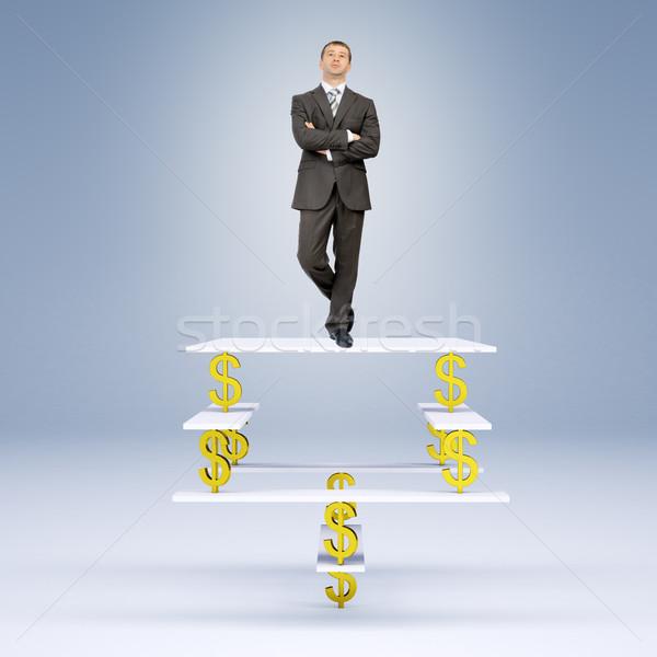Człowiek stałego równowagi znak dolara biznesmen patrząc Zdjęcia stock © cherezoff