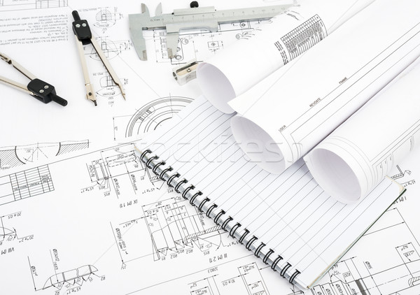 Stock photo: Architecture plan and rolls of blueprints
