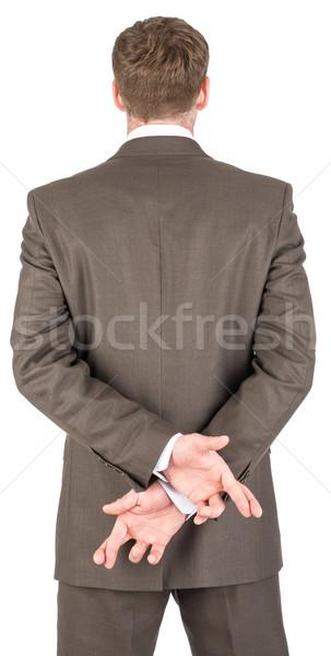 üzletember ujjak mögött hát izolált fehér Stock fotó © cherezoff