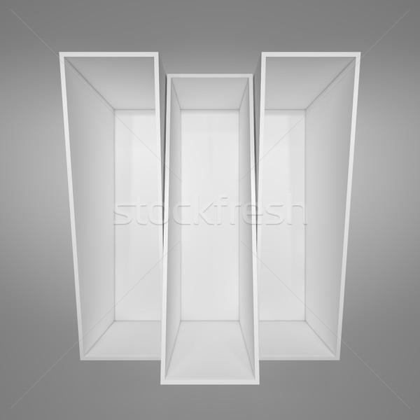 Empty white bookshelf. Grey background Stock photo © cherezoff