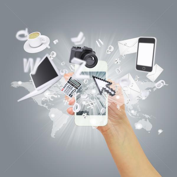 Hand holding smartphone. Concept electronics Stock photo © cherezoff