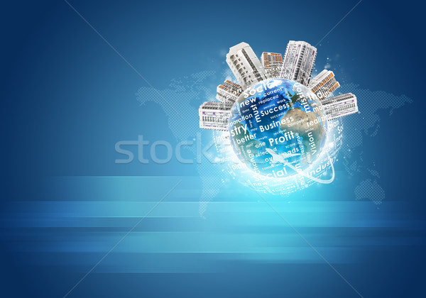 Earth with buildings and business words. World map as backdrop Stock photo © cherezoff