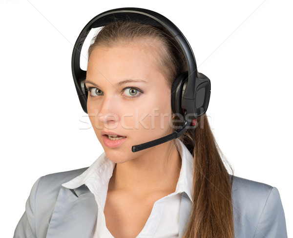 Businesswoman in headset with her head half-turned to right Stock photo © cherezoff