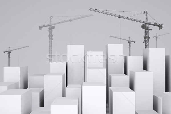 White cubes with wire-frame tower cranes. Cropped image Stock photo © cherezoff