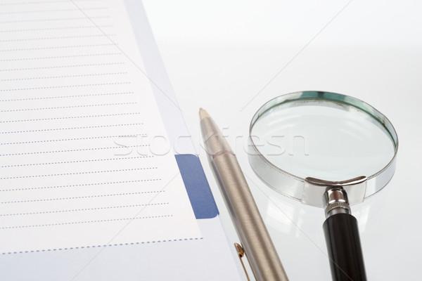 Hand glass and notebook Stock photo © cherezoff