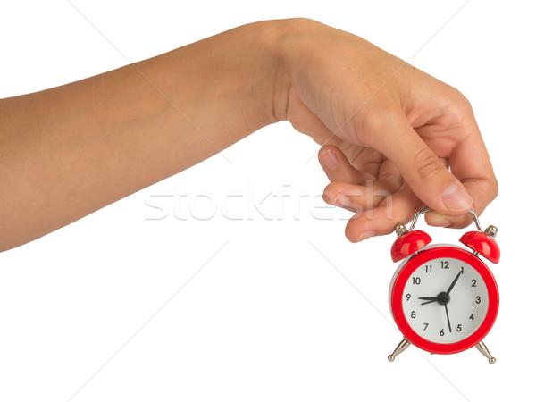Kéz tart ébresztőóra fehér izolált Stock fotó © cherezoff