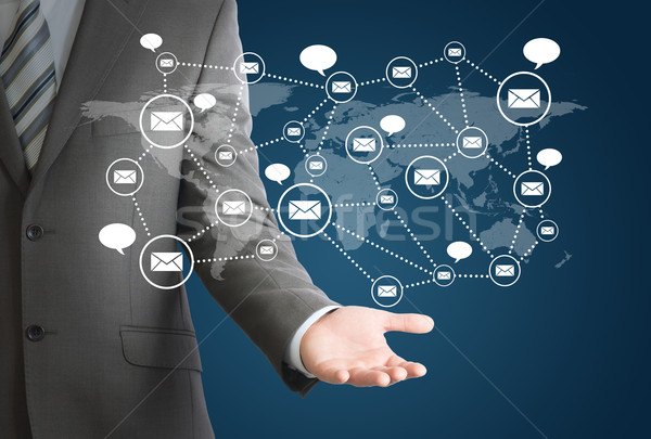 Businessman and network of contacts on hand Stock photo © cherezoff