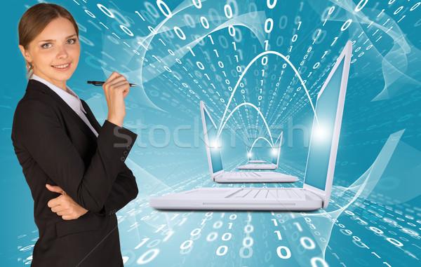 üzletasszonyok toll laptopok izzik üzlet kéz Stock fotó © cherezoff